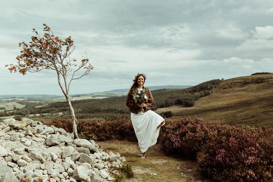 bride near tree on the fields in Northumberland