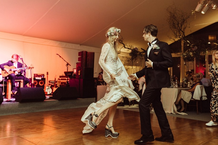 bride and groom on the dance floor for their first dance