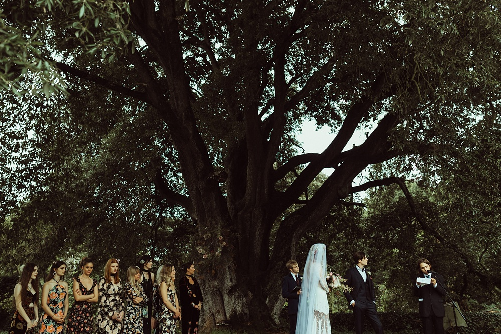 outdoor wedding ceremony under big tree in New Forest