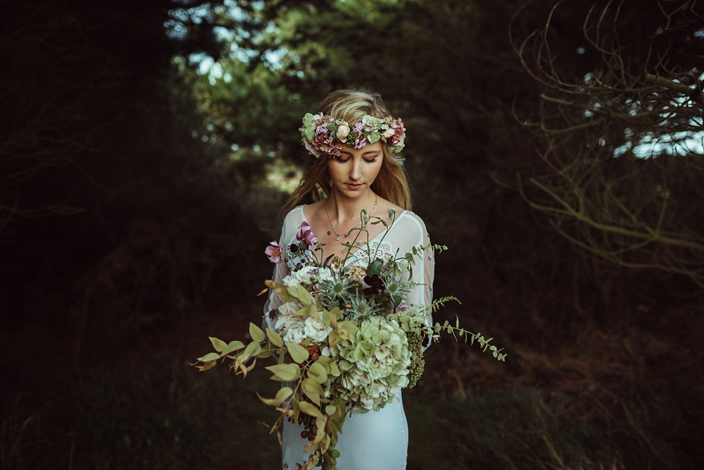Edgy bride holding her beautiful bouquet by JamJar Florists in London