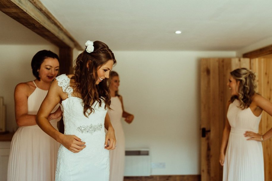 bride getting ready with bridesmaids for Cotswolds wedding