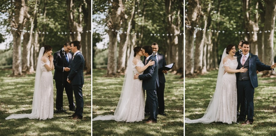 outdoor wedding ceremony first kiss