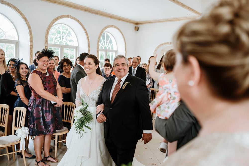 bride and dad walking down the aisle at northbrook park