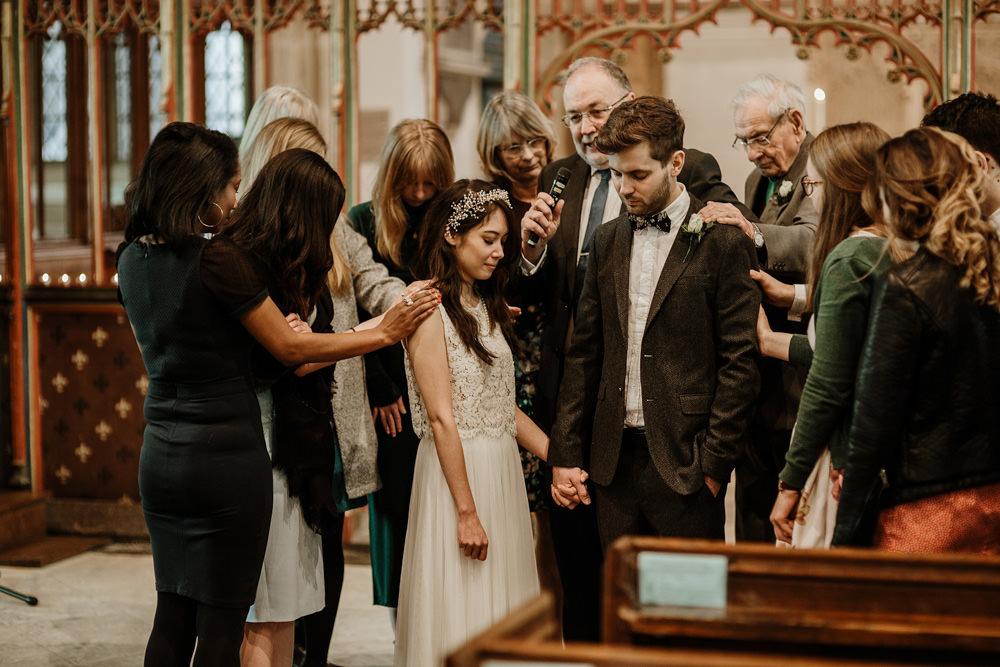 prayer during religious wedding ceremony