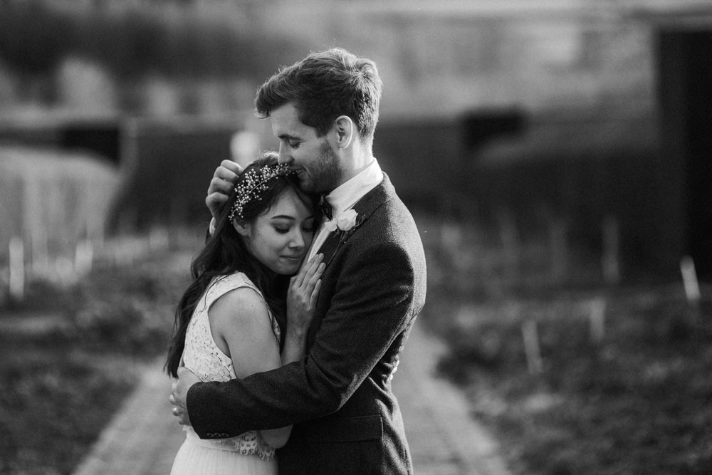 black and white image of groom holding bride at the ethicurean restaurant Bristol