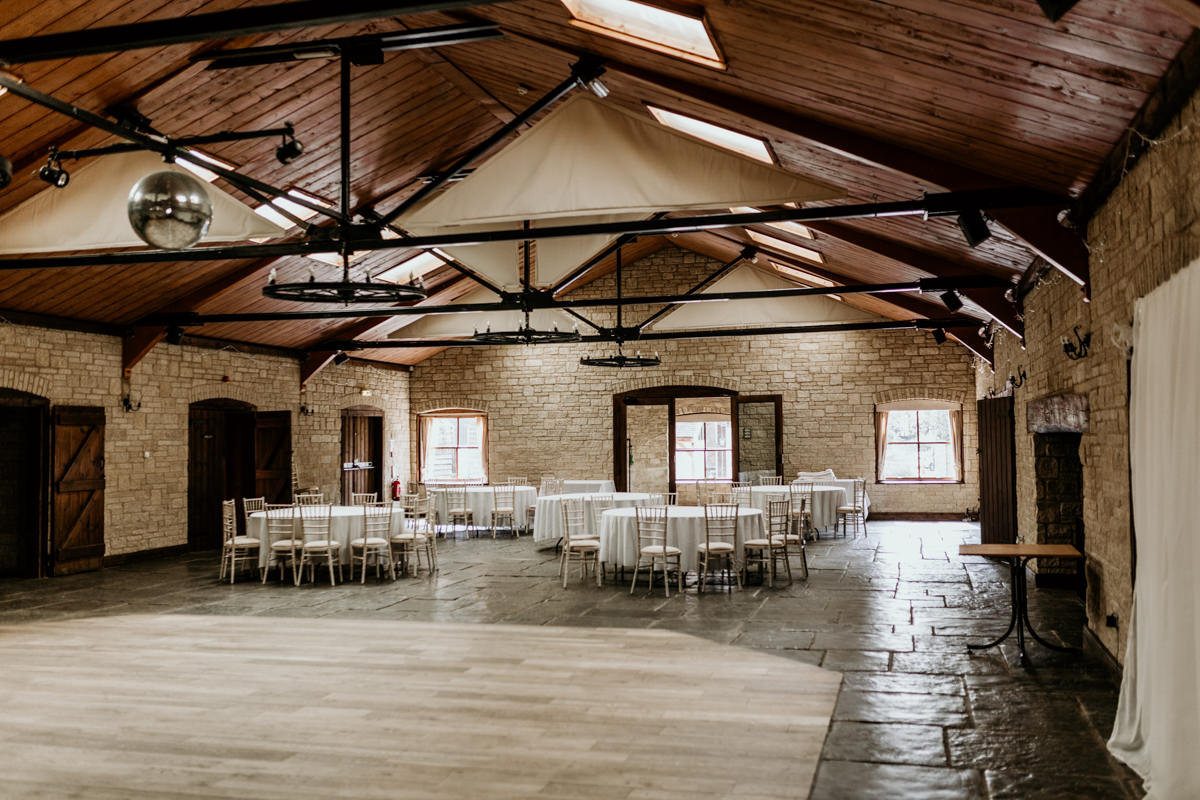 wedding reception arrangement and dance floor at The Barn at Berkeley Wedding Venue Cotswolds | Green Antlers Photography