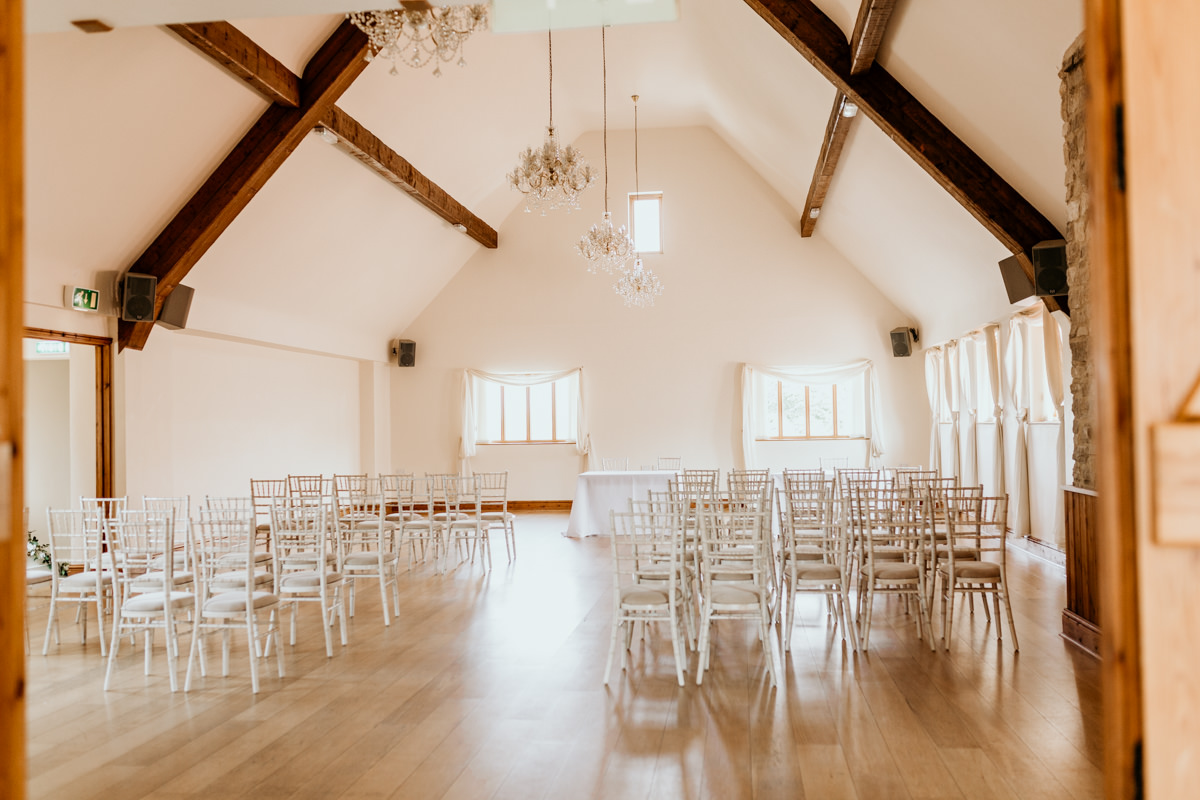 wedding ceremony area inside The Barn at Berkeley Wedding Venue Cotswolds | Green Antlers Photography