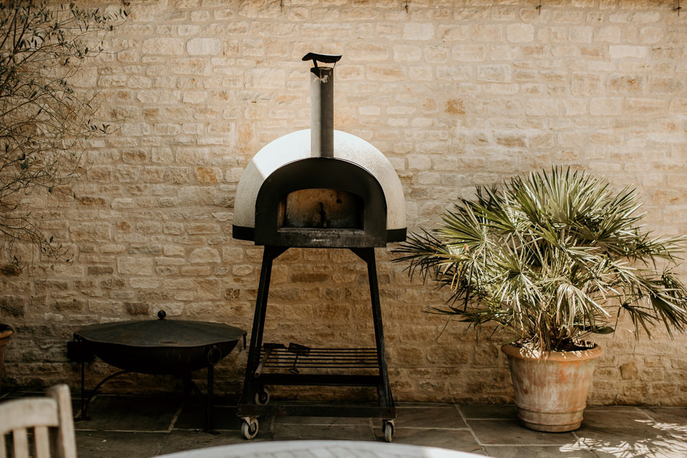 outdoor barbecue and oven in the gardens of The Kingscote Barn Wedding venue