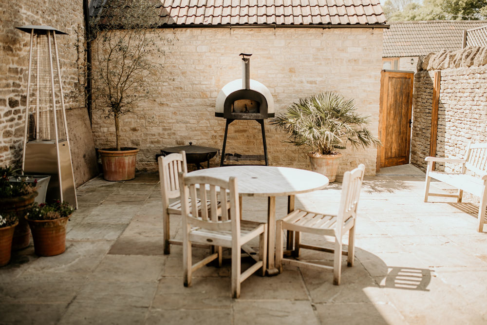 garden and barbeque area at The Kingscote Barn Wedding venue in Cotswolds