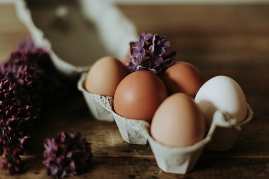 free range eggs with lilac flowers in the Cotswolds countryside