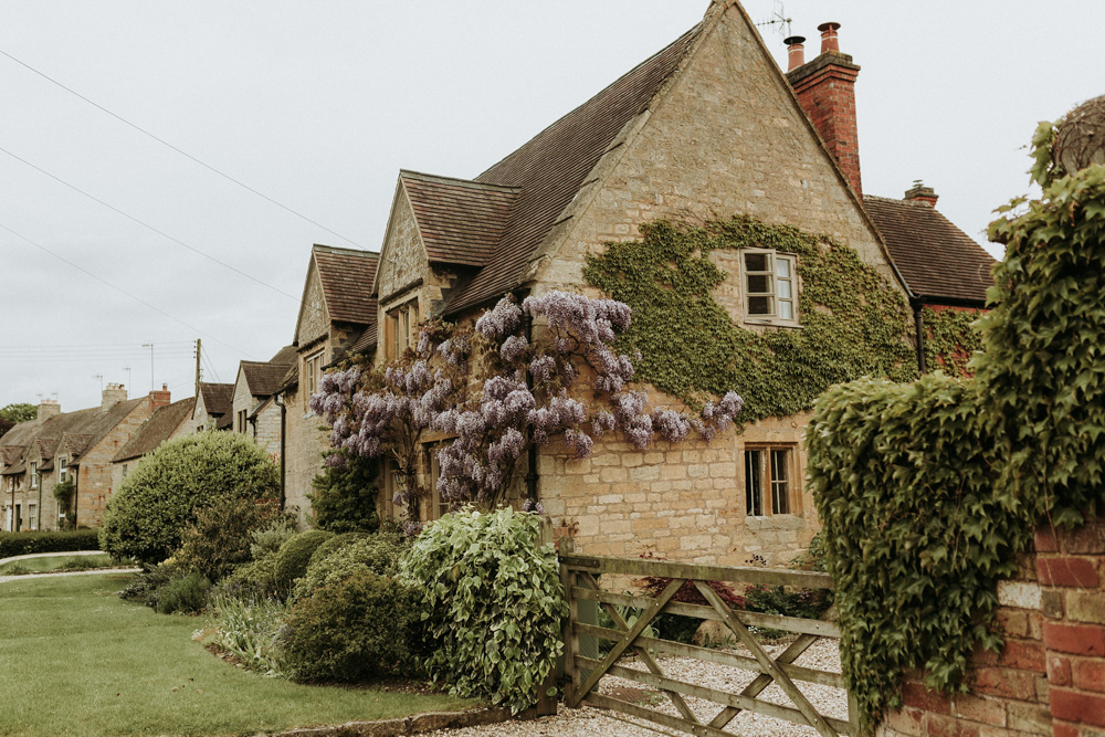 Visteria flowers on Stone walls of house in the Cotswolds countryside