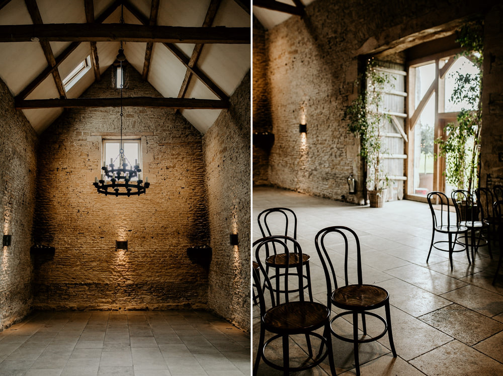Stone Barn ceremony area details with old wooden chairs at Stone Barn Cotswolds
