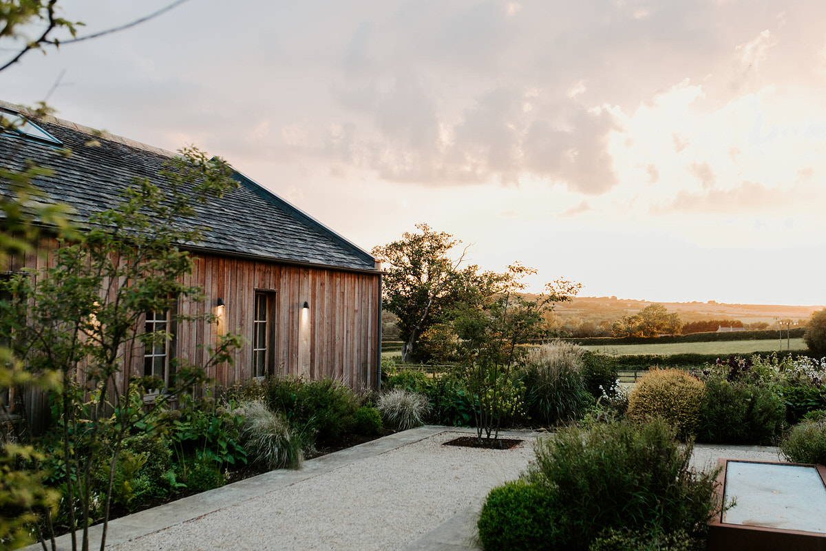sunset over wedding barn in cotswolds