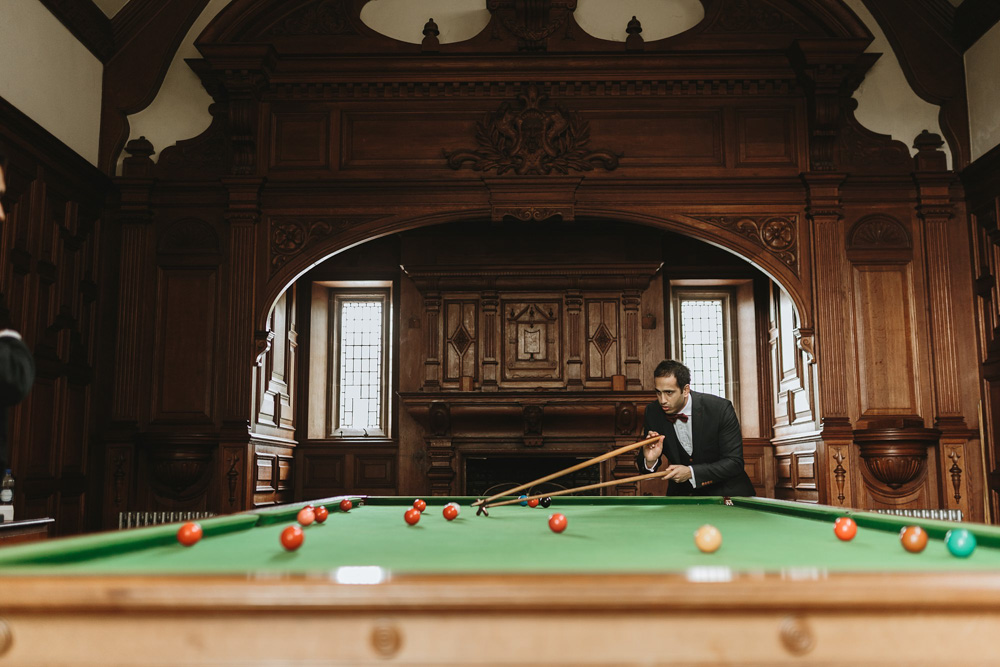 groomsman playing pools on the day of the wedding at Plas Dinam Country House