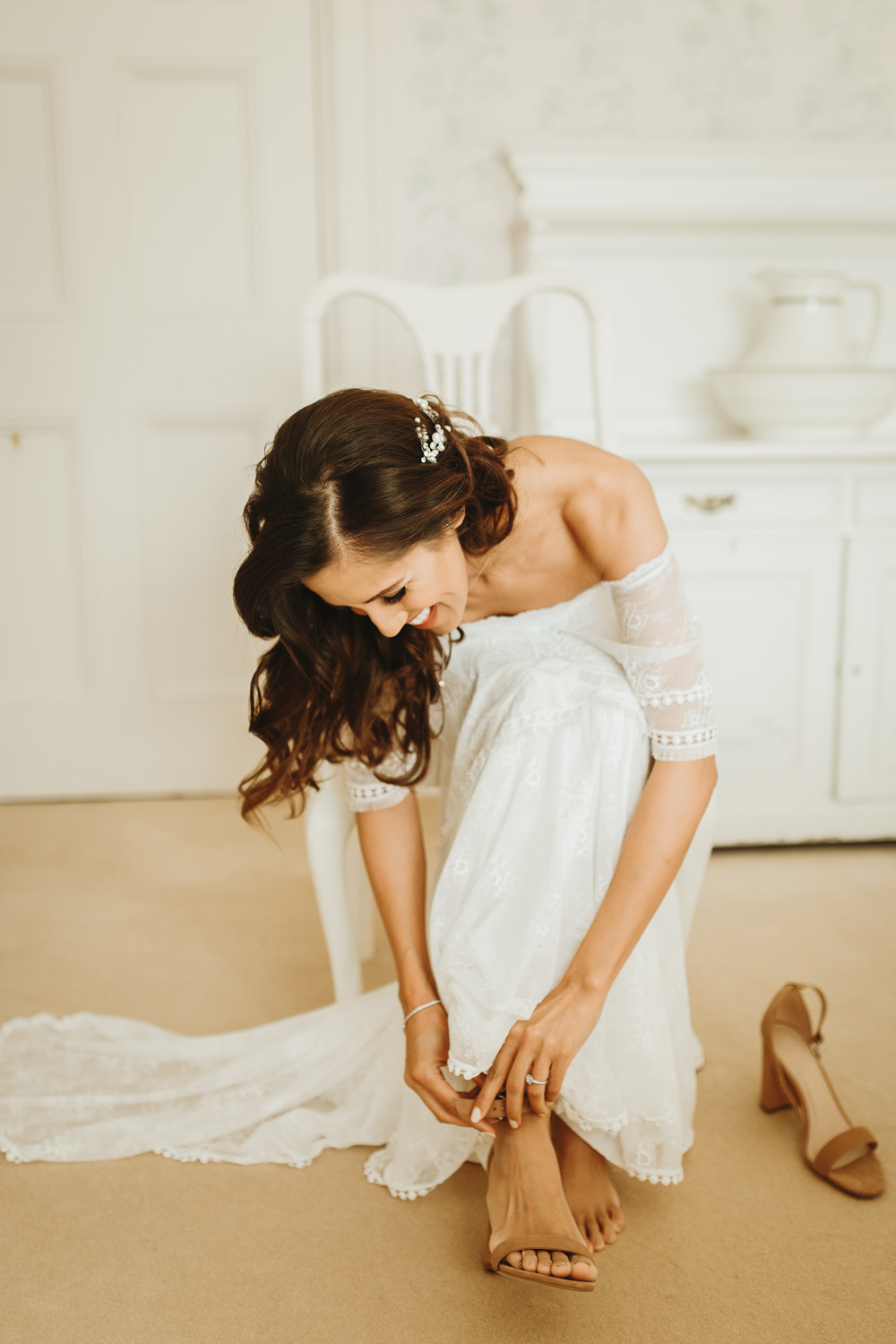 bride getting her wedding shoes on at Plas Dinam Country House