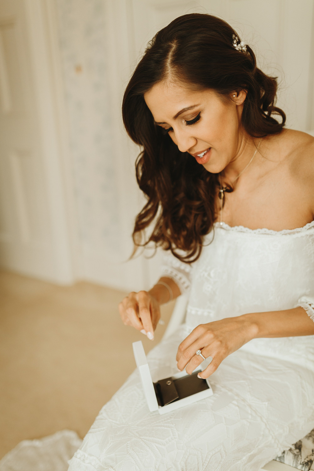 bride getting jewellery on at Plas Dinam Country House