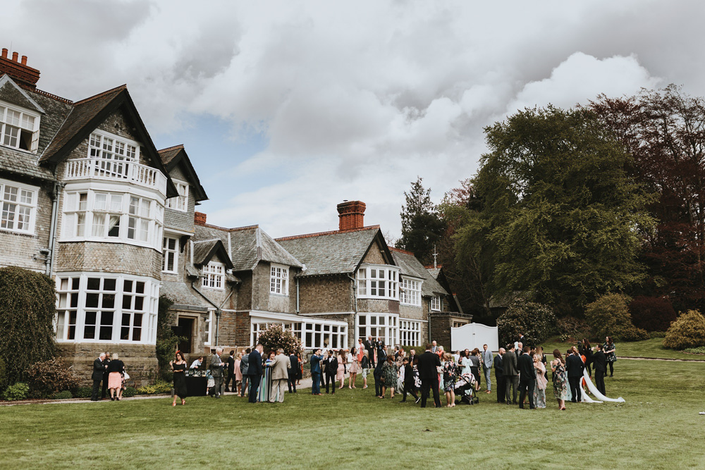 guests having canapes during their outdoor wedding at plas dinam country house