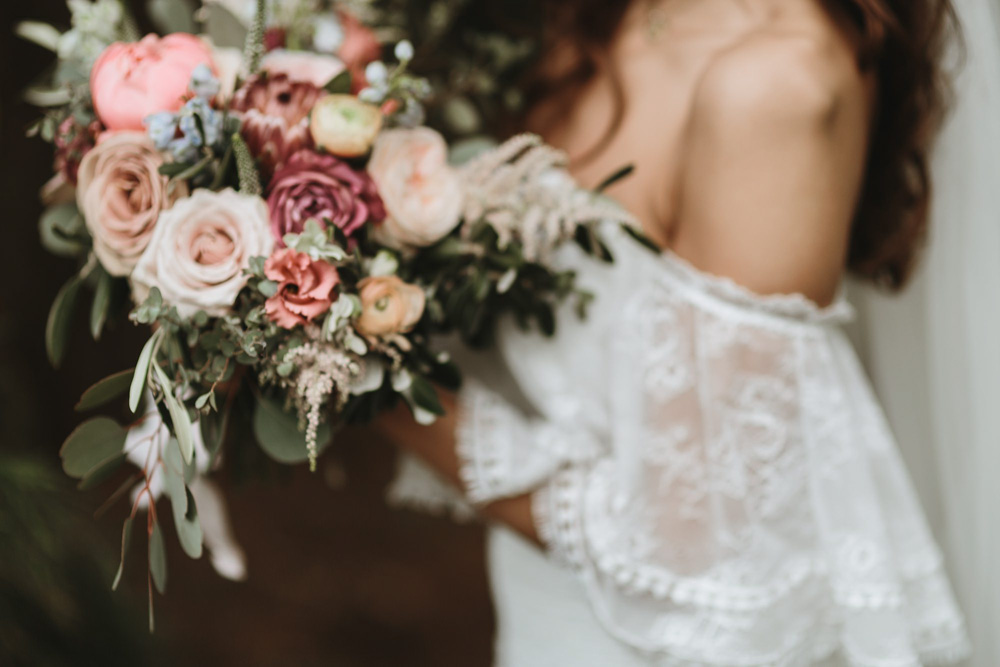 flowers and dress details at plas dinam country house wedding