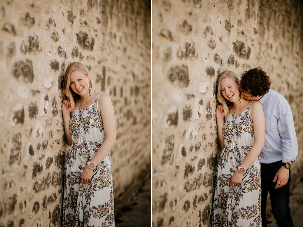 couple for their engagement shoot near a stone wall in Oxford city