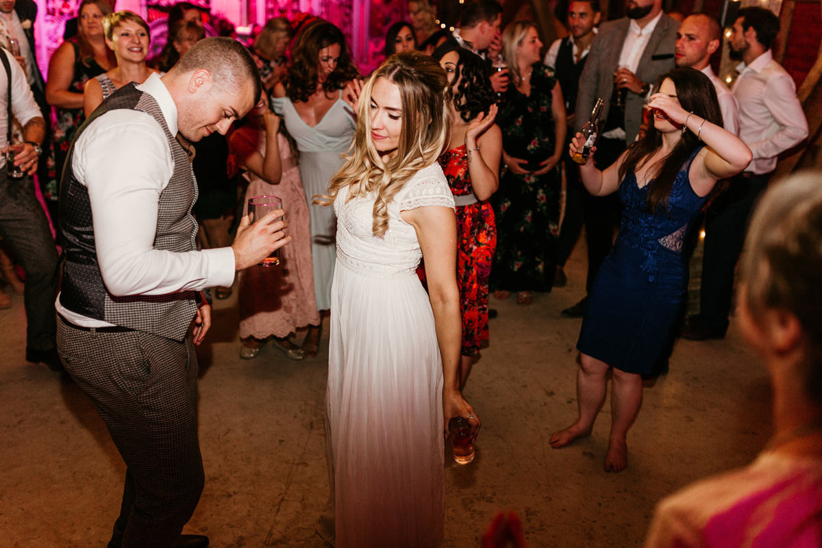 bride and groom dancing during the party at preston court wedding venue by Canterbury wedding photographers
