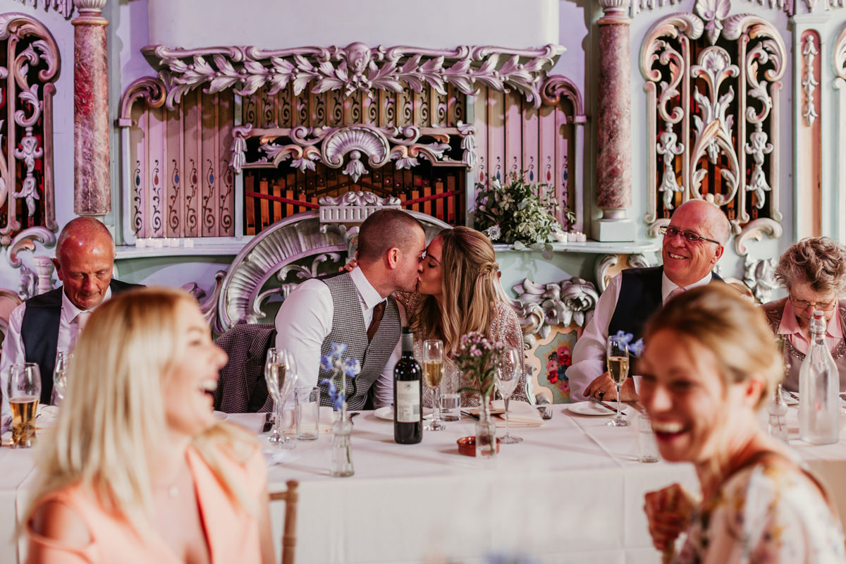 bride and groom kiss during the wedding reception at preston court wedding venue by Canterbury wedding photographers