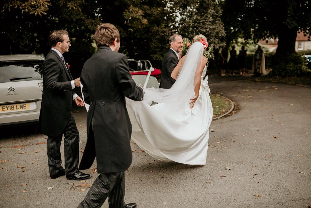 bride wearing a Jesus Peiro wedding dress getting ready for church wedding ceremony