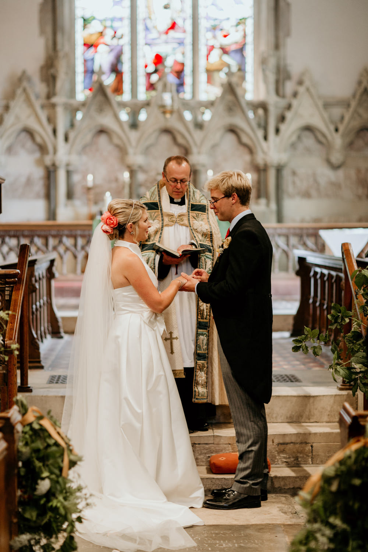 church wedding ceremony vows with bride wearing a Jesus Peiro wedding dress