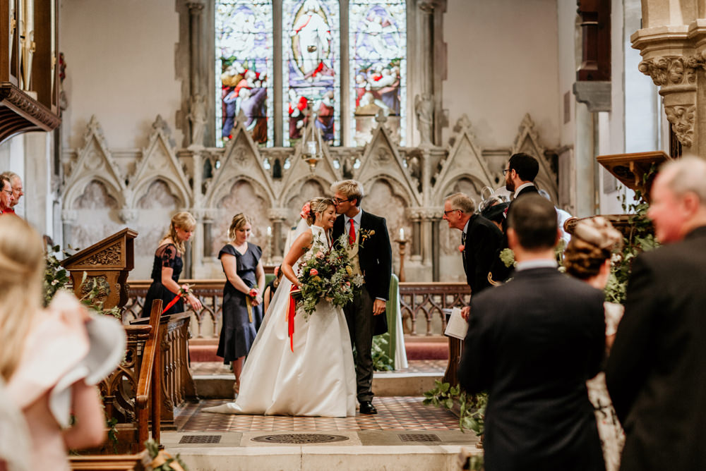 bride and groom walk down the aisle after church wedding ceremony