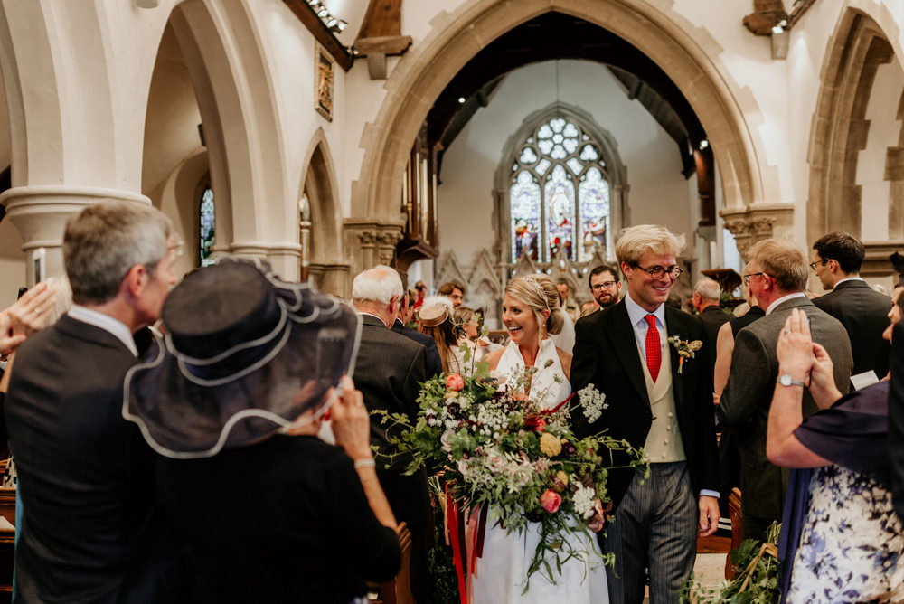 beaming bride and groom after church wedding ceremony Chichester