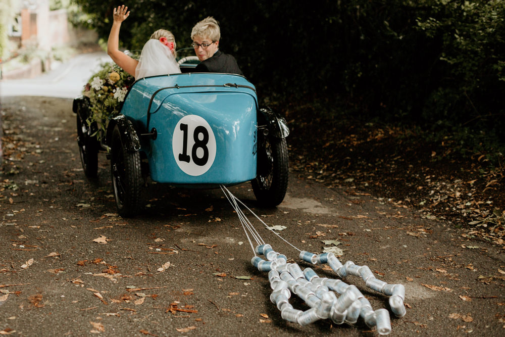 blue Austin 7 Ulster vintage car for their just married car