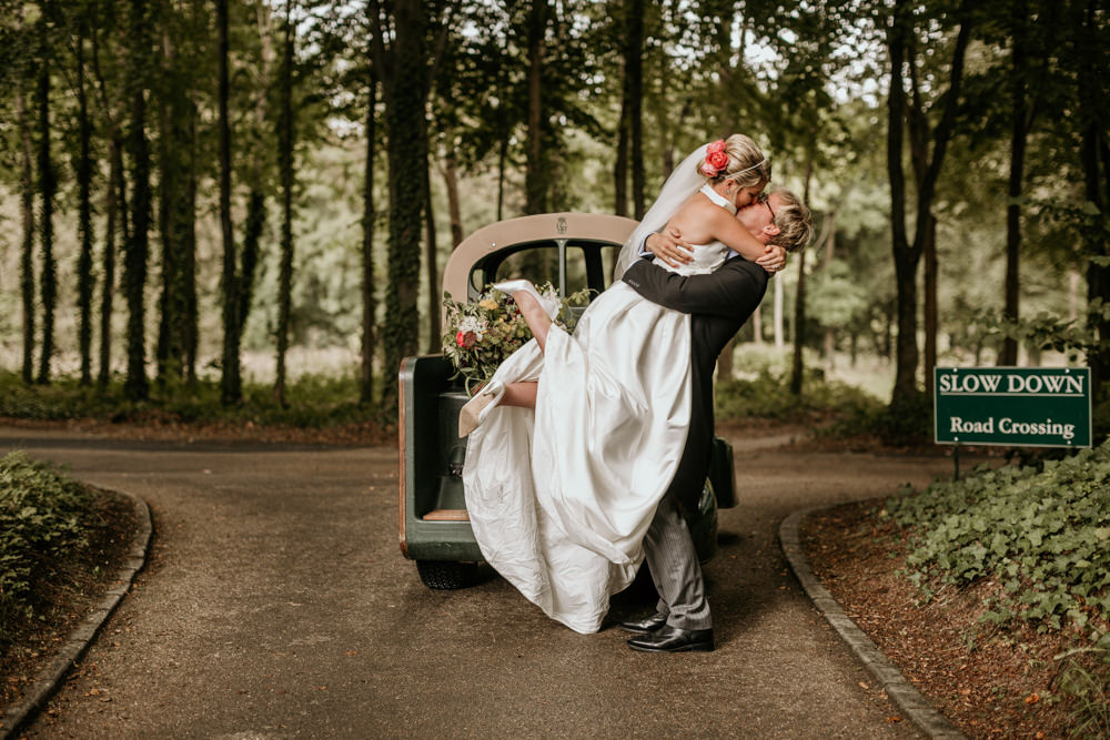 just married bride and groom at The Kennels Goodwood wedding venue
