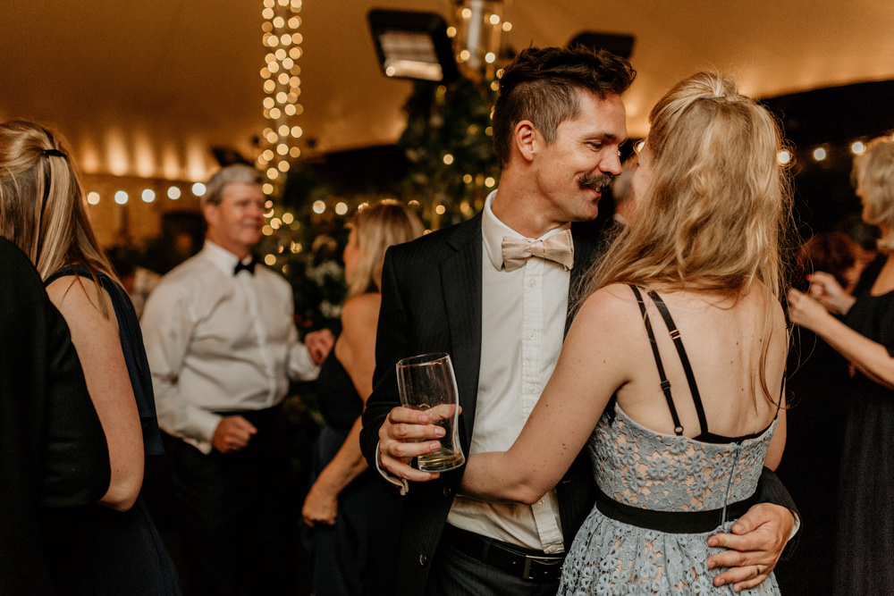 guests on dance floor during a wedding reception at The Kennels Goodwood wedding venue