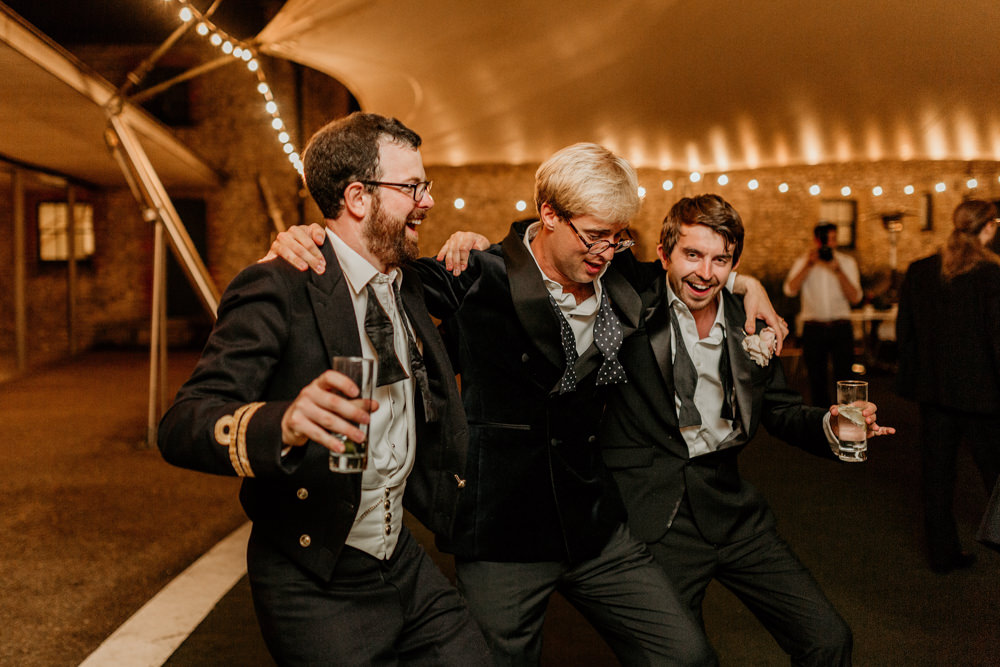 guests dancing on the dance floor during a party at The Kennels Goodwood wedding photographer