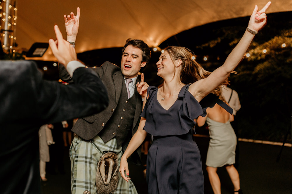 guests dance during The Kennels Goodwood wedding England