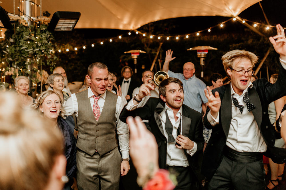 guests dancing during wedding party at The Kennels Goodwood England