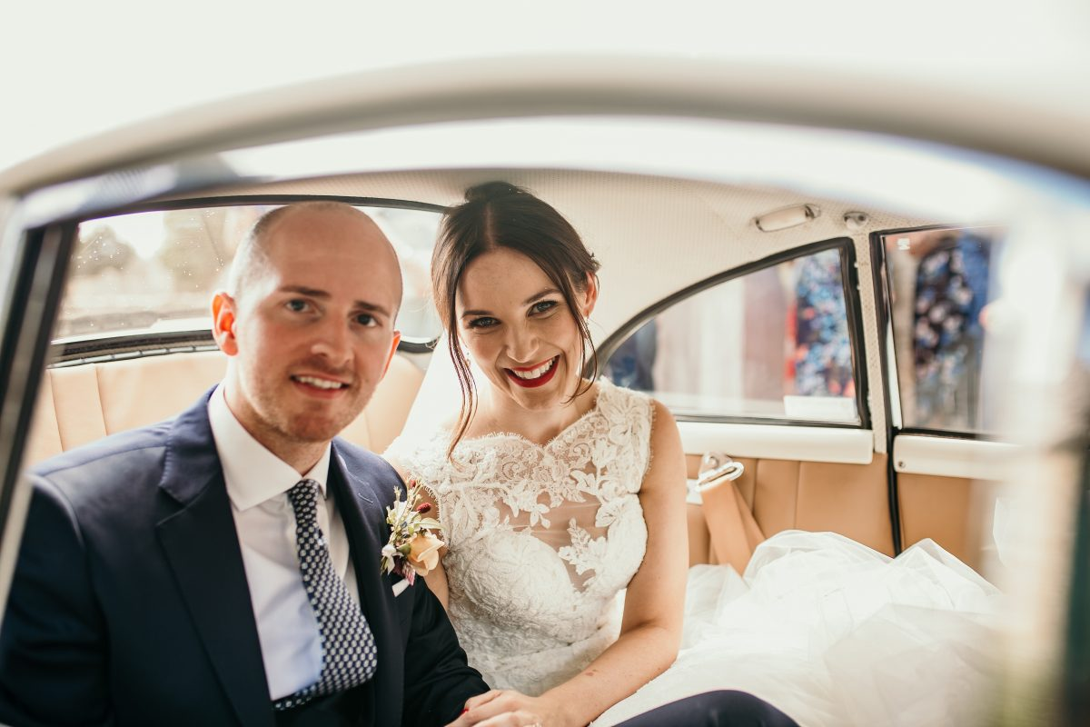 bride and groom in wedding car at Merriscourt Barn Wedding venue by Cotswolds wedding photographer