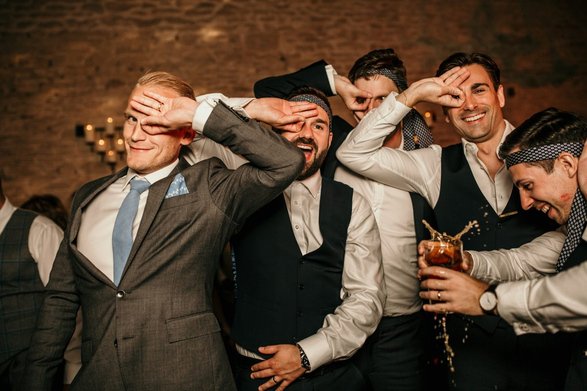 guys being silly on dance floor during a Merriscourt Barn Wedding venue by Cotswolds wedding photographer