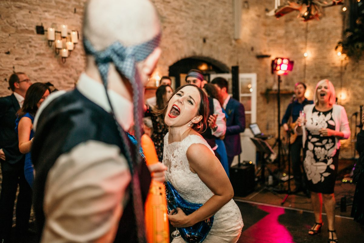 bride and groom on the dance floor at Merriscourt Barn Wedding venue by Cotswolds wedding photographer