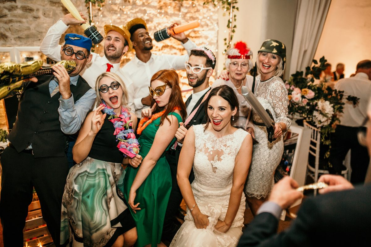 photo booth during the wedding party at Merriscourt Barn Wedding venue by Cotswolds wedding photographer