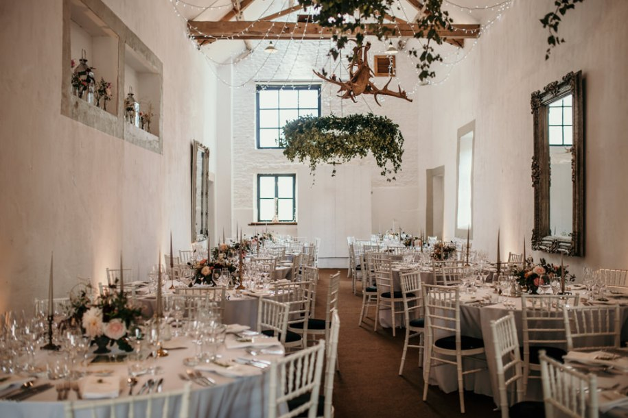 wedding barn decoration with round tables at Merriscourt Barn wedding venue