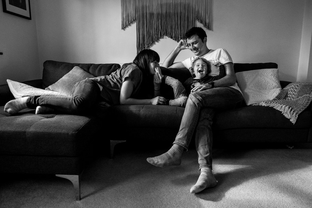 family spending time on the sofa in the living room in cotswolds