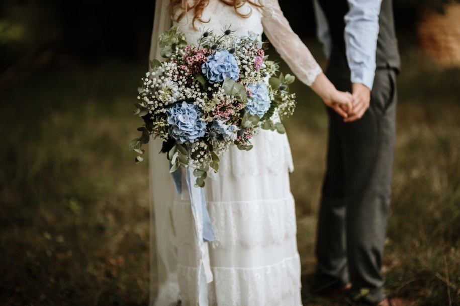 blue hydrangea wedding bouquet for a bohemian bride