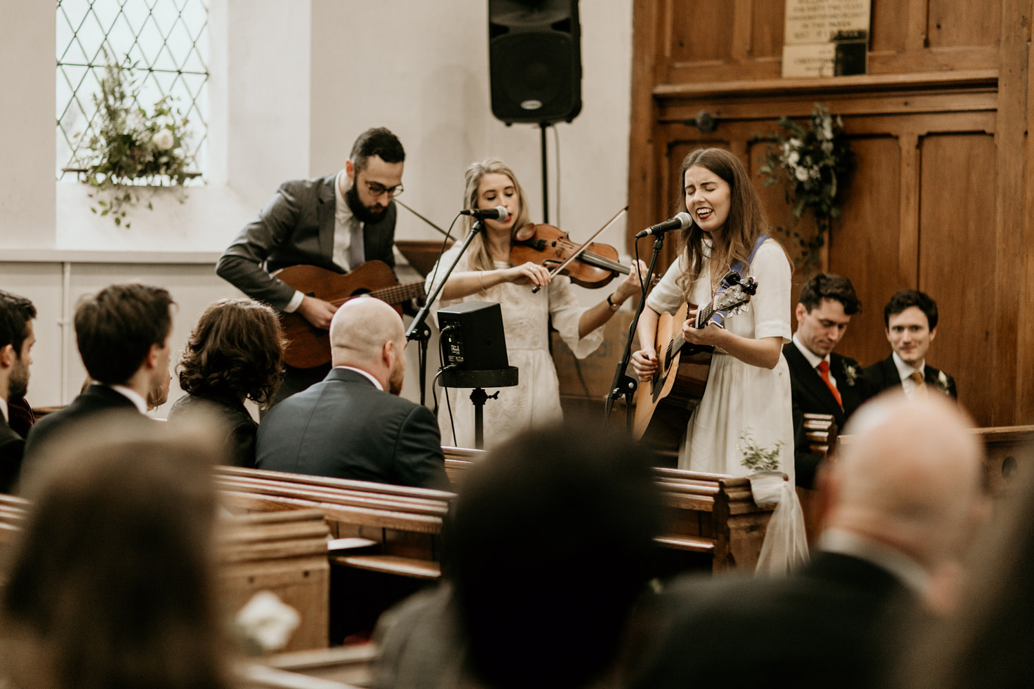 singers in church during the Stroud wedding ceremony, Cotswolds