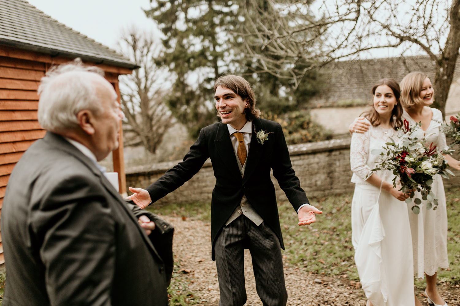 bride and groom greeting friends after their wedding ceremony Stroud