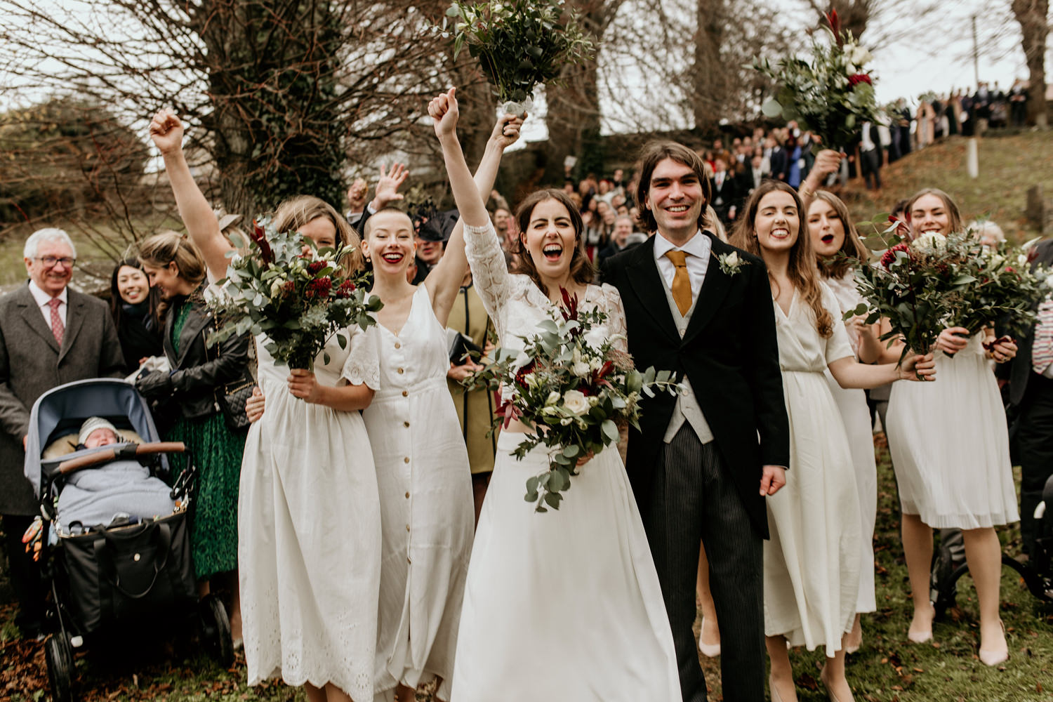 guests cheering after the Stroud wedding ceremony Cotswolds