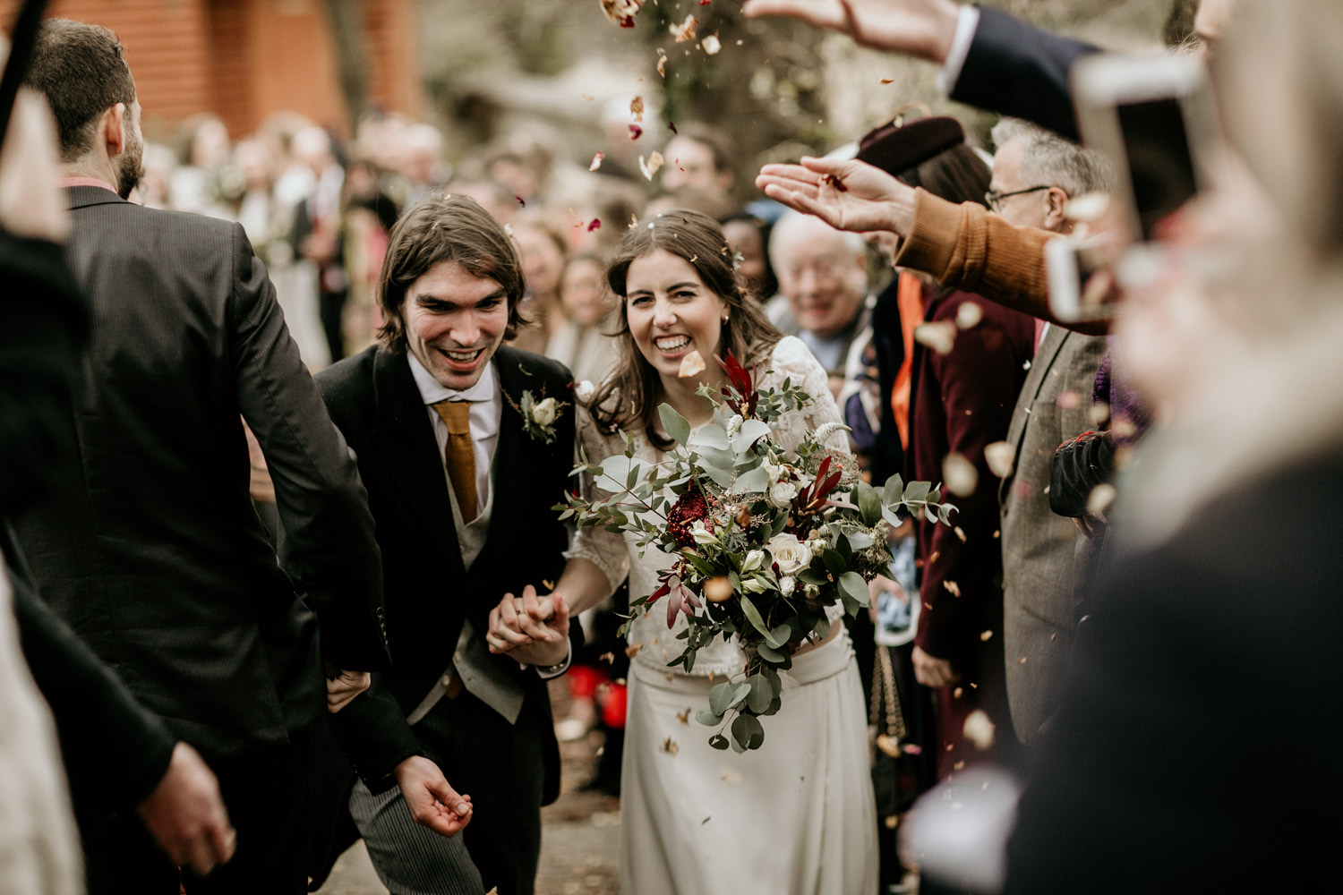 confetti shot after the Stroud church wedding ceremony Cotswolds