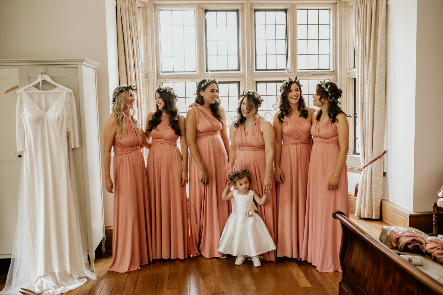 bridesmaids wearing a multyway wear coral bridesmaids dress
