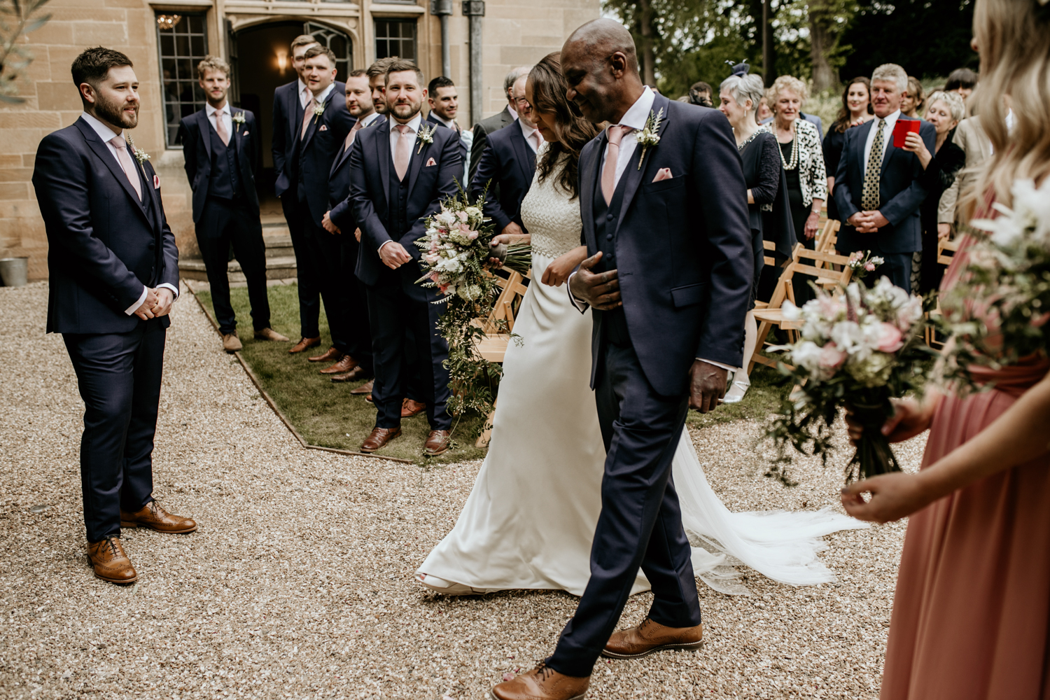dad and bride walking down the aisle to meet the groom at Coombe Lodge Blagdon wedding venue