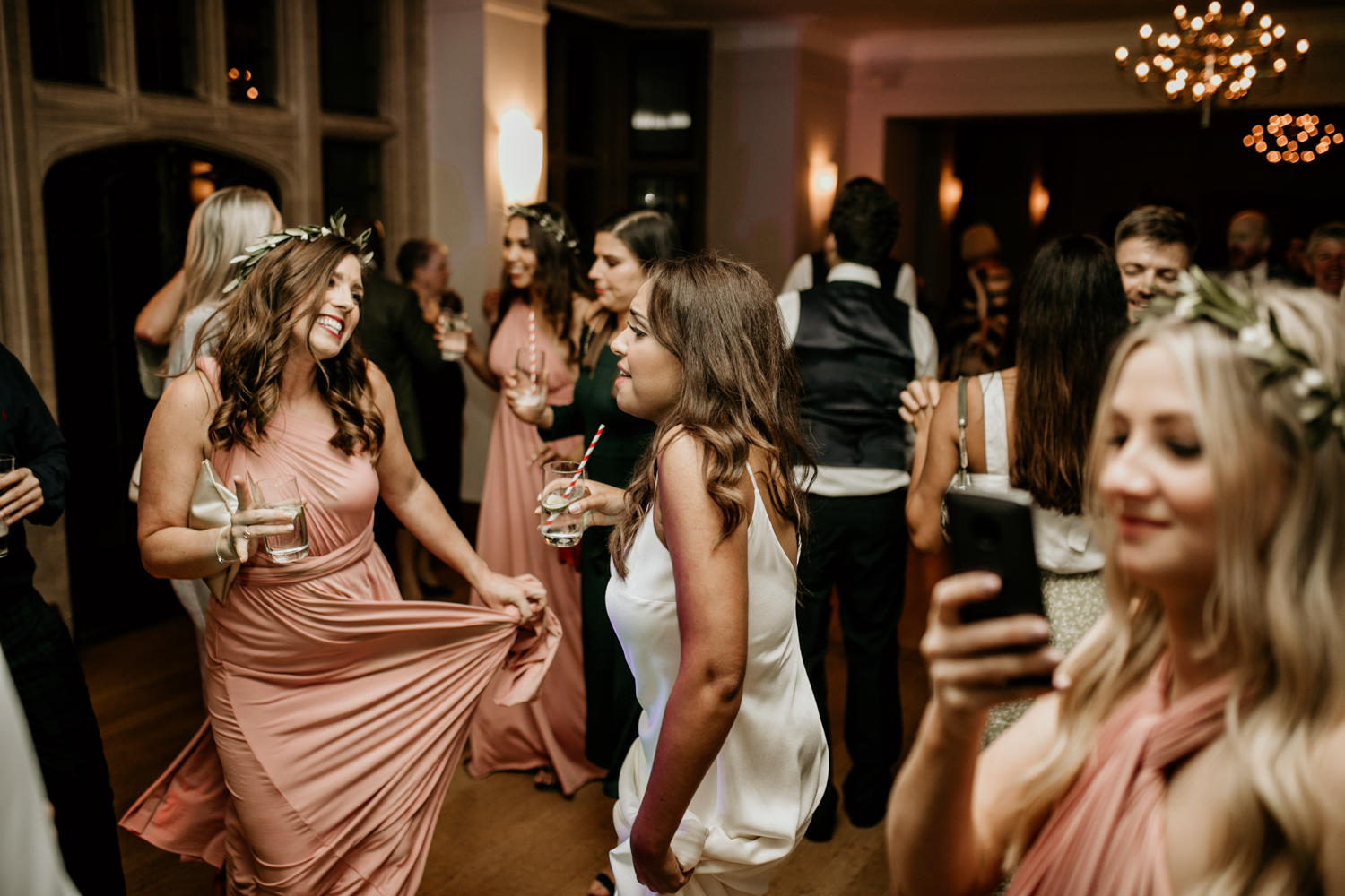 bride dancing with guests at Coombe Lodge Blagdon wedding venue