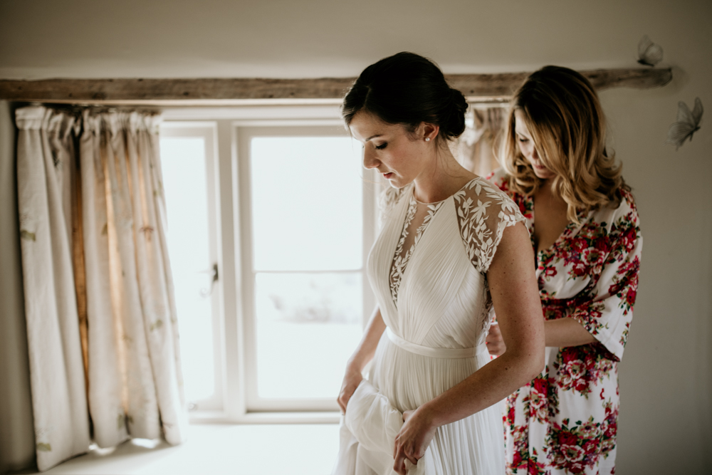 bride getting ready with her sister before a wedding ceremony in Poulton